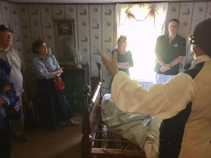 Tom explaining how the bed was made, and the coverings thereupon to his visitors.