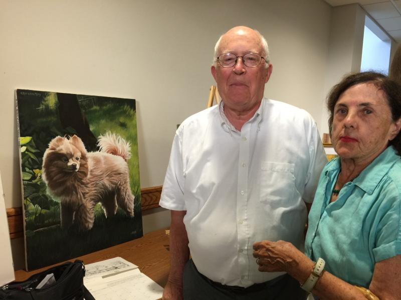 Earl and Mary Ellen Edwards admire the wonderful painting of this dog named